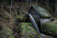 Old  water mill in the forrest Stock Photo