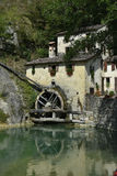 Old water mill in Italian village. An old water mill in Italian village Royalty Free Stock Images