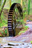Old water mill in nature Stock Photo