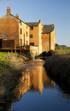 Old Water Mill on the River Avon, Little Lawford. Royalty Free Stock Photo