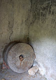 Old water mill stones. Interior of the old water mill and old, abandoned mill stones, once used to grind wheat and corn Royalty Free Stock Photo