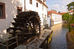 Old water-mill and water wheel Stock Photo