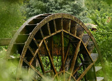 Old water mill wheel. Still turning Royalty Free Stock Photography