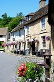 Old water pump and Castle Inn, Castle Combe. Royalty Free Stock Photos