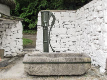 Old water pump and granite water trough Royalty Free Stock Photo