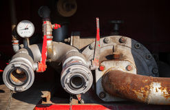 Old Water pump with hydrants Royalty Free Stock Image