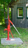 Old water pump by logcabin. Royalty Free Stock Photography