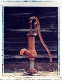 Old water pump, Polaroid image transfer. Old water pump against wooden wall, Polaroid image transfer on watercolor paper, rough texture Royalty Free Stock Photos