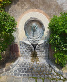 Old water source, Veszprem, Hungary. Public water source more than 100 years old, located on street of Old Town Castle of Veszprem town, Hungary royalty free stock photography