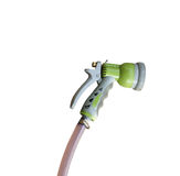Old water spray gun and hose isolated on white background Stock Photo