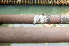 Old Water supply pipeline, rust on metal pipeline Stock Photo