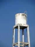 Old water tank with blue sky Stock Photo