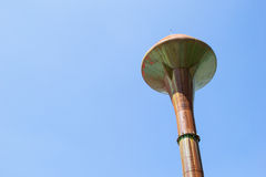 Old water tank with blue sky Royalty Free Stock Photo