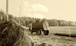 Old water tank in a field Royalty Free Stock Photos