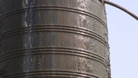 Old water tank overflow in asia, Nepal stock footage