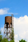 Old water tank tower on blue sky Stock Photo