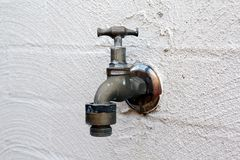 Old Water Tap. On white wall Stock Photography