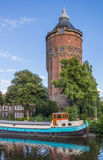 Old water tower at a canal in Groningen Royalty Free Stock Photos