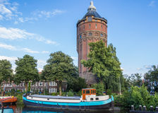 Old water tower at a canal in Groningen Stock Image