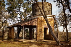 The old Water Tower. An old Water storage tank in the Texas Hill Country Stock Photography