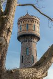 Old water tower in Woerden, The Netherlands. Old water tower with hoarding in Woerden, The Netherlands stock image