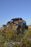 Old water truck in the weeds and long grass Stock Image