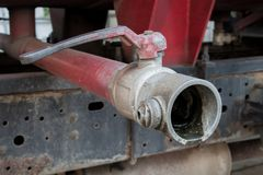 Old water valve on a fire truck.  Stock Photos