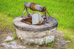 Old water well with bucket Royalty Free Stock Photography