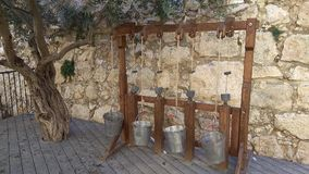Old water well with buckets - Olive tree in old tower of David i royalty free stock photography