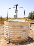 Old Water Well With Pulley and Bucket Stock Image