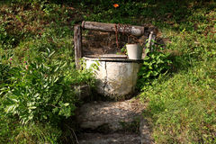 Old water well. rural scenery Royalty Free Stock Image