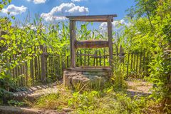 Old water well. Old wooden water well abandoned in village stock photo