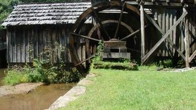 An old water wheel being turned at a preserved grist mill. Water providing power at the historic mabry mill along the blue ridge parkway stock video footage