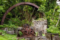 Rusty water wheel in forest Royalty Free Stock Photography