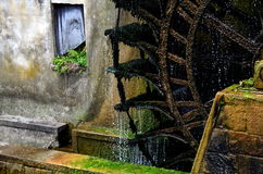 Old watermill. Old water wheel in Italy Stock Images