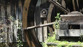 An old water wheel turning at a preserved grist mill. An historic, working wheel generating power as seen at mabry mill, virginia stock video footage