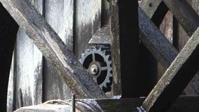 An old water wheel turning at a preserved grist mill. An historic, working wheel generating power as seen at mabry mill, virginia stock footage