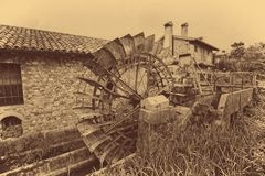 Old water wheels of a watermill. Vintage style picture. Adding grain to give an old photo effect Royalty Free Stock Images