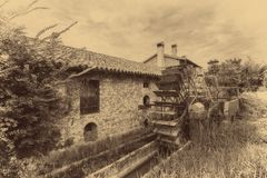 Old water wheels of a watermill. Vintage style picture. Adding grain to give an old photo effect Royalty Free Stock Photography