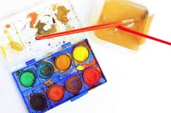 Old watercolor palette box with brush Stock Photos