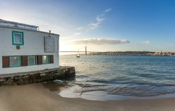 Old waterfront restaurant on sumer day in Lisbon royalty free stock photo