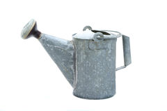 Old Watering Can. Vintage metal watering can on white background Royalty Free Stock Photography