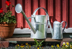 Old watering cans Stock Image