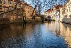 Old watermill on Chertovka river in Prague. Stock Images