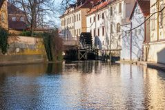 Old watermill on Chertovka river in Prague. Royalty Free Stock Photography