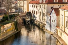 Old watermill on Chertovka river in Prague. Royalty Free Stock Images