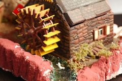 Old watermill model scene. An old and dirty plastic watermill model scenery represent the model toy and hobby concept related idea royalty free stock images
