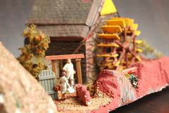 Old watermill model scene. An old and dirty plastic watermill model scenery represent the model toy and hobby concept related idea royalty free stock photo
