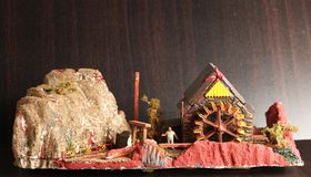 Old watermill model scene. An old and dirty plastic watermill model scenery represent the model toy and hobby concept related idea royalty free stock image