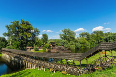 Old watermill and old wooden bridge. Royalty Free Stock Photo